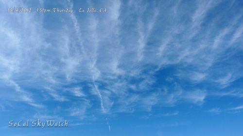 10/4/2012 La Jolla 1:51pm - Just sprayed chem trail across the wispy row cloud formation.