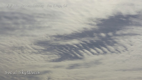 10/6/2012 San Diego 9:44am - A section of the sky with minimal chem haze particulate reveals the HAARP wave signature as a chem jet flies across to fill in the space.