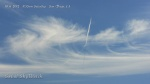 "10/6/2012 San Diego 11:53am - The earlier plane leaves another trail and then curves left with a dark line ""black beam"" shadow on the chem cloud particle fallout and drift."