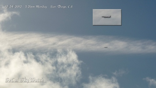A low altitude plane flies by over north San Diego, which is not where normal commercial air traffic travels. Note the size of the plane compared to the expanded chemtrail cloud.