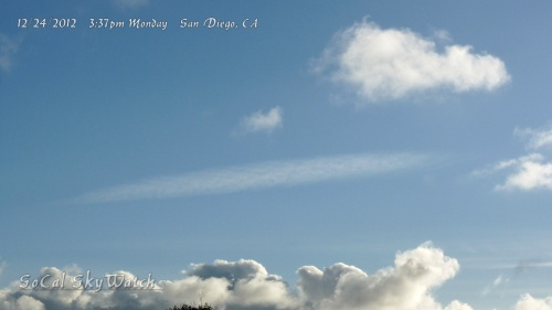 Chemtrail plumes above the clouds on Christmas Eve.
