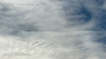 Expanded chemtrail cloud with HAARP wave lines forming nearby.