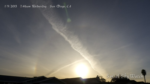 7:46am Morning sun crossed with massive chemtrail plumes with solar halo and sun dog.