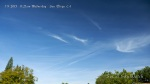 11:27am Parallel chemtrails with rows of streaky lines streaming off and bright white chem dumps.