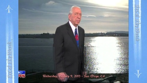KUSI Weather news time-lapse video. John Coleman walks in front of chemtrail grid patterns passing by.